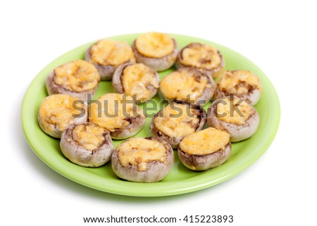 A plate of baked champignons with cheese