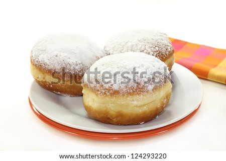 a plate of donuts on a white background