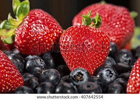 A plate of fresh strawberry and blueberry fruit - stock photo