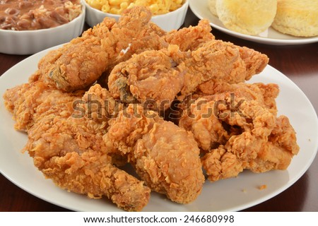 A plate of fried chicken with side dishes - stock photo