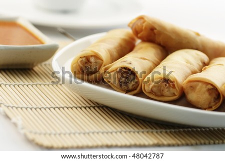 A plate of fried spring rolls or Popiah, a popular Malaysian snack - stock photo