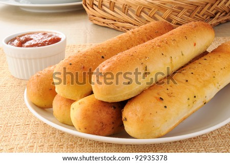 a plate of garlic bread sticks - stock photo