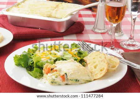 A plate of healthy vegetable lasagna with wine - stock photo
