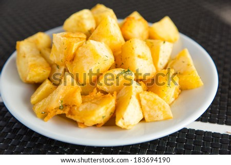 A plate of homemade baked sweet potato served, ready to eat - stock photo