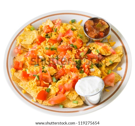A plate of nachos and cheese, isolated on a white background. - stock photo
