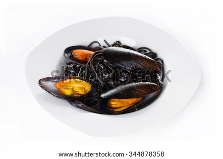 A plate of pasta and mussel, isolated on white
