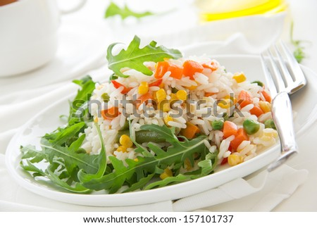 A plate of rice with vegetables. Selective focus.