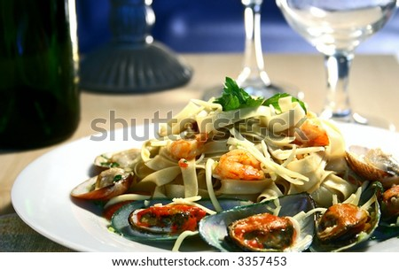 a plate of seafood pasta with shrimp,mussels and clam