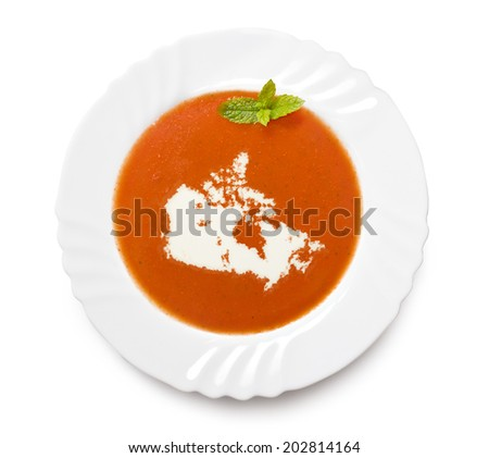 A plate tomato soup with cream in the shape of Canada.(series) - stock photo