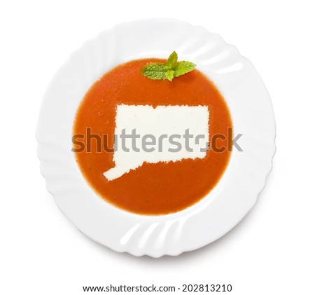 A plate tomato soup with cream in the shape of Connecticut.(series) - stock photo