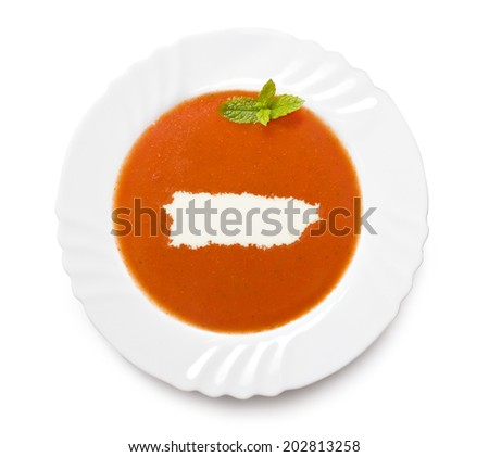 A plate tomato soup with cream in the shape of Puerto Rico.(series) - stock photo