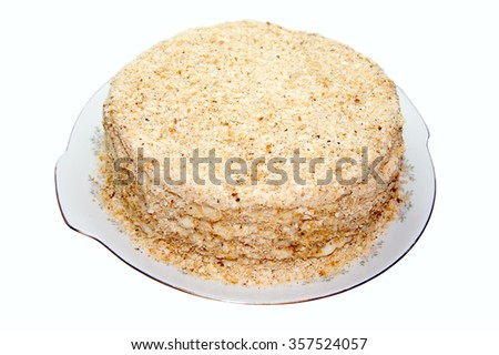 A plate with a cake on a white background