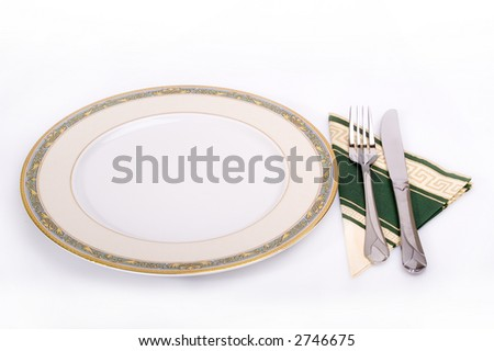 a plate with a fork and a knife - stock photo