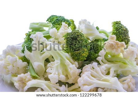 A plate with broccoli and cauliflower - stock photo