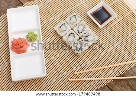 A plate with ginger and wasabi and a set of sushi - stock photo