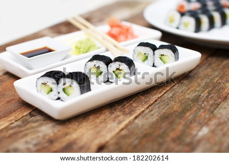 A plate with some sushi on it - stock photo