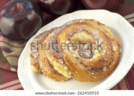 A plate with two delicious hot apple danish with selective focus on danish