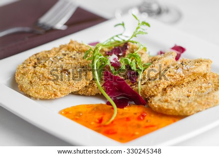 A plated meal of fried green tomatoes and pepper jelly