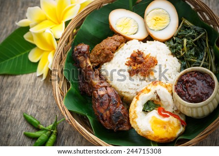 A plates of Delicious 'Ayam Penyet' or Nasi Campur, Indonesia - stock photo