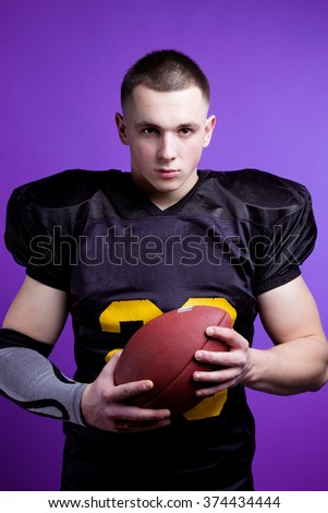 A player in american football with the ball. - stock photo