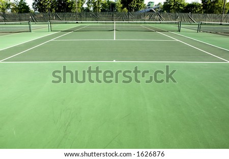 A players-eye view of a tennis court. - stock photo