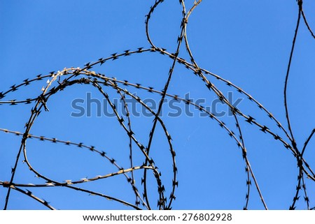 a plot of land is covered with barbed wire - stock photo