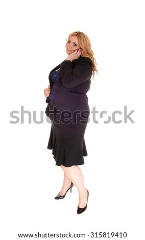A plus size blond business woman, standing for white background talking on her cell phone, in full length.  - stock photo