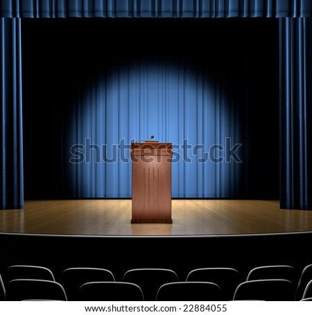 A podium in a spot light on stage.