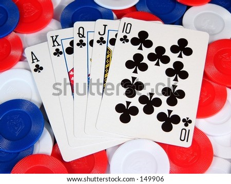 a poker hand on a  pile of poker chips