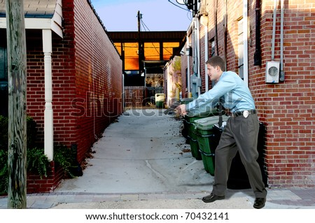 A police detective man on the job with a gun - stock photo
