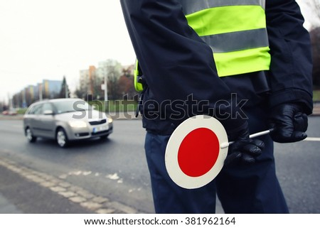 A police man checking the traffic - stock photo