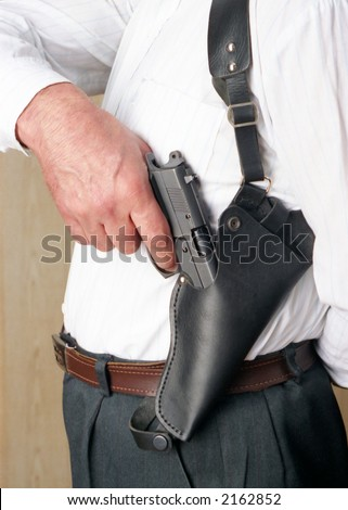 A police officer with gun in his hand is ready for action. - stock photo