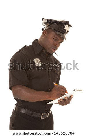 A policeman writing a ticket looking down with a serious expression. - stock photo