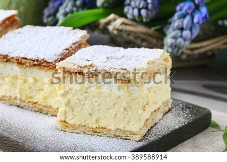 A Polish cream pie made of two layers of puff pastry, filled with whipped cream. - stock photo