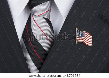 A politician wearing an American flag lapel pin symbolizes patriotism. - stock photo