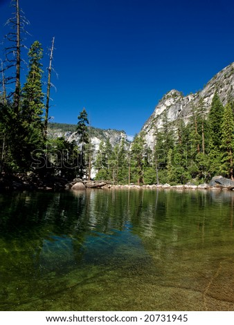 A pond near high waterfall in Yosemite National Park - California - stock photo