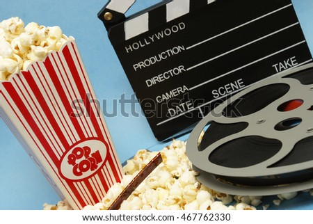 A popcorn and film reel are placed in a theme representing the film industry.