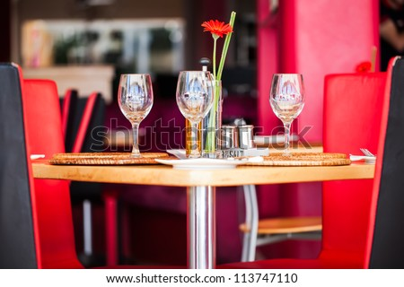 A popular restaurant with a bright coloured design. - stock photo