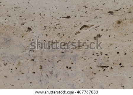 A popular variety of travertine Travertine Classic warm beige color with a pronounced banding and heterogeneity of pattern. Banded texture resembling travertine a woody drawing.  - stock photo