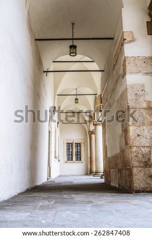 A portico is a porch leading to the entrance of a building, or extended as a colonnade, with a roof structure over a walkway, supported by columns or enclosed by walls. - stock photo
