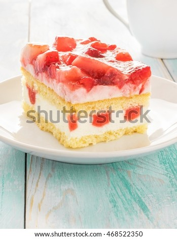 A portion of fresh cream strawberry sponge cake on a plate