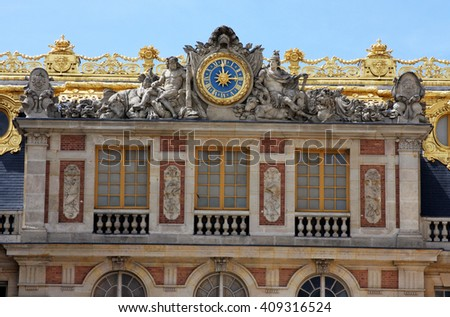 A Portion of the Front Facade, with a Working Clock, of Famous Palace of Versailles. The Palace Versailles was a Royal Chateau Located Near Paris France. - stock photo