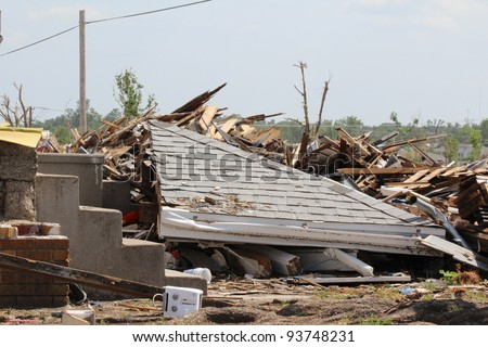 A portion of the roof of this house has collapsed onto the homes remains after an EF5 tornado ripped through the area, causing destruction of historic proportion. - stock photo