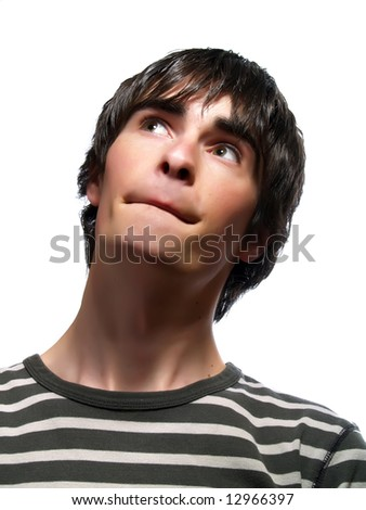 A portrait about a trendy attractive guy who is looking up and he is dreaming. He is wearing a striped t-shirt. - stock photo