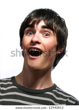 A portrait about a trendy attractive young man who is looking towards and he is surprised. He is wearing a striped t-shirt. - stock photo
