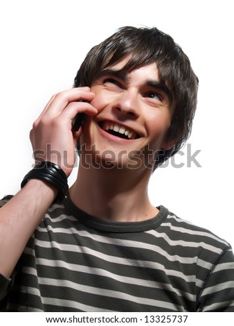 A portrait about a trendy cute guy who is laughing and he is speaking with somebody by mobile phone. He is wearing a striped t-shirt. - stock photo