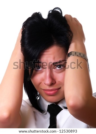 A portrait about a young pretty businesswoman with black hair who has a headache because of the hard work and she is holding her head. She is wearing a white shirt and a black tie. - stock photo