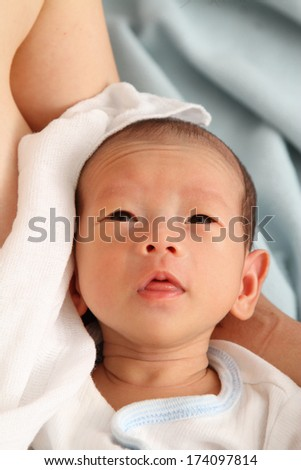 A portrait of a baby boy - stock photo