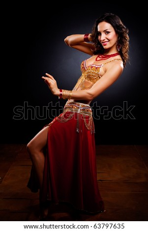 A portrait of a beautiful belly dancer - stock photo