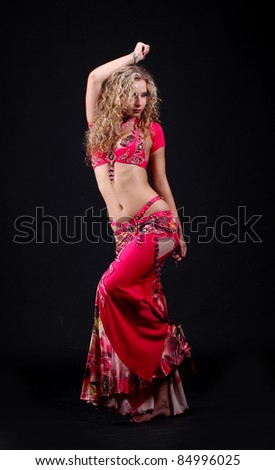 A portrait of a beautiful belly dancer on black background